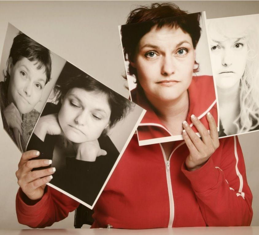 concept-of-woman-holding-pictures-of-multiple-personalities-picture-id108125059-1024x768